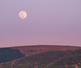Beautiful moon scene on hill Stock Photo