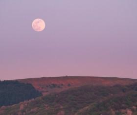 Beautiful moon scene on hill Stock Photo
