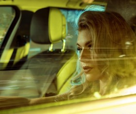 Blonde girl driving limousine Stock Photo 01