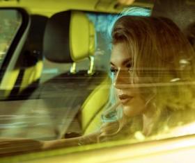 Blonde girl driving limousine Stock Photo 01