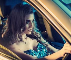 Blonde girl driving limousine Stock Photo 02