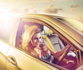 Blonde girl driving limousine Stock Photo 03