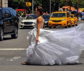 Bride crossing the road Stock Photo