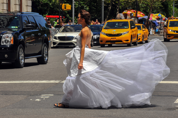 Bride crossing the road Stock Photo