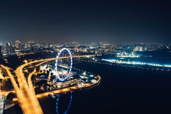 Bright Ferris wheel in the darkness Stock Photo