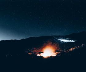 Bright fire light on dark mountain Stock Photo