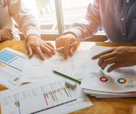 Business people who analyze market data with colleagues Stock Photo 02