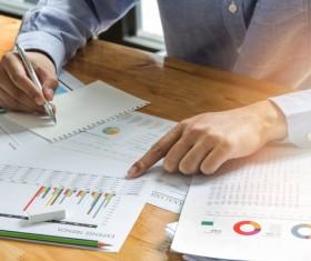 Businessman calculating market data Stock Photo 05