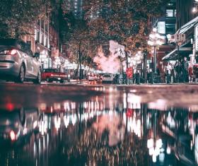 Bustling city lights at night Stock Photo