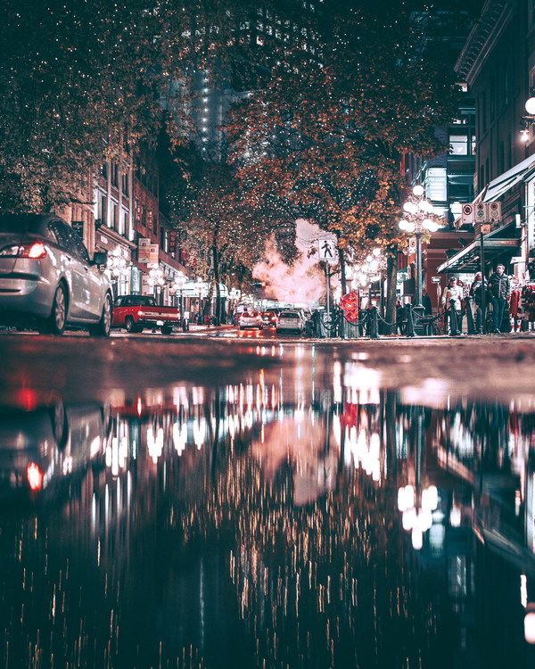 Bustling city lights at night Stock Photo