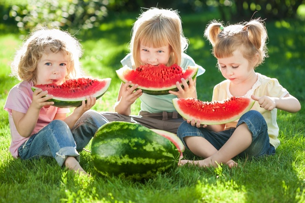 Children eating watermelon in summer Stock Photo
