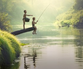 Children fishing in the river Stock Photo