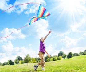 Children flying a kite on the grass Stock Photo