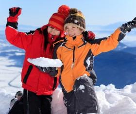 Children having fun outdoors in winter Stock Photo 01