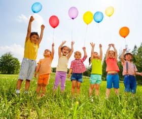 Children holding balloons Stock Photo