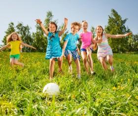 Children kicking the ball on the grass Stock Photo 02