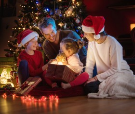 Christmas Eve received a teddy bear gift happy little sister Stock Photo
