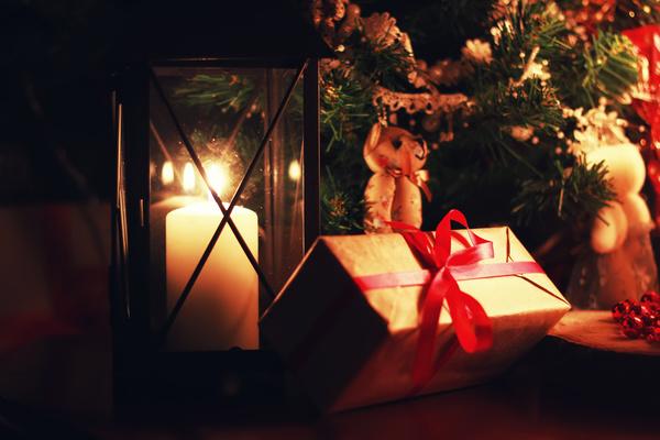 Christmas candlelight and gift box Stock Photo