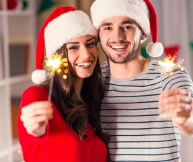 Christmas couple put fireworks Stock Photo 01