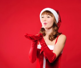 Christmas day woman blowing kiss Stock Photo 01