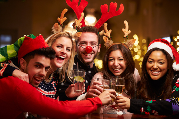 Christmas gathering of friends Stock Photo