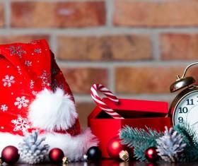 Christmas hat and alarm clock on the desktop Stock Photo
