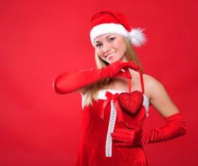 Christmas woman holding heart-shaped decoration Stock Photo