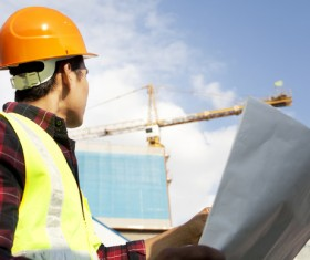 Construction engineer looking at drawings Stock Photo