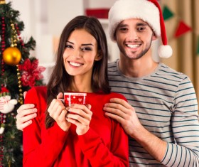 Couple in front of Christmas tree Stock Photo