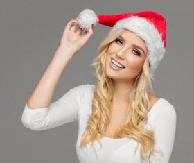 Cute blonde model wearing santa cap Stock Photo 04