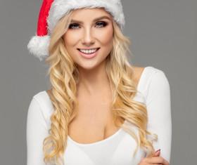Cute blonde model wearing santa cap Stock Photo 05