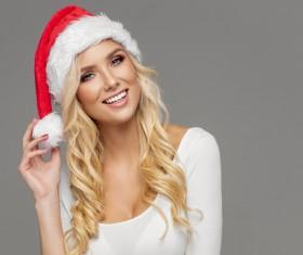 Cute blonde model wearing santa cap Stock Photo 06