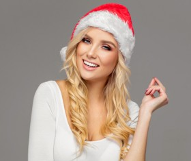 Cute blonde model wearing santa cap Stock Photo 07