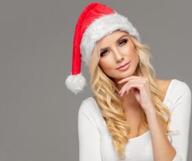 Cute blonde model wearing santa cap Stock Photo 08