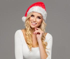 Cute blonde model wearing santa cap Stock Photo 09