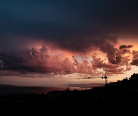 Dark clouds in the sunset sky Stock Photo