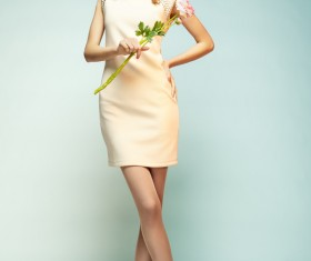 Elegant beautiful girl holding flowers Stock Photo 01