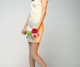 Elegant beautiful girl holding flowers Stock Photo 02