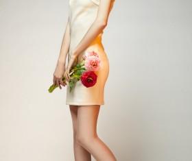 Elegant beautiful girl holding flowers Stock Photo 03