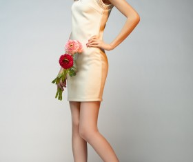 Elegant beautiful girl holding flowers Stock Photo 04