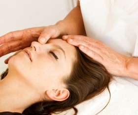 Facial massage and maintenance Stock Photo