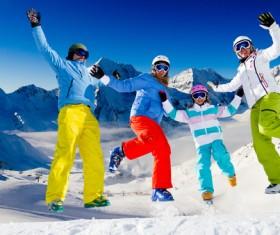 Family enjoying winter skiing fun Stock Photo 01