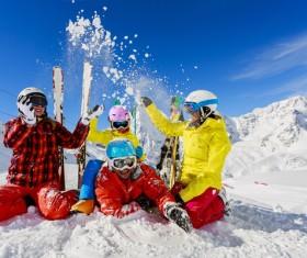 Family enjoying winter skiing fun Stock Photo 03