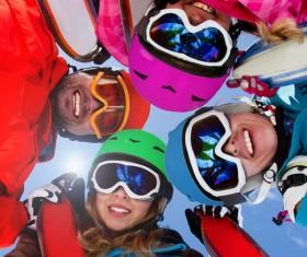 Family enjoying winter skiing fun Stock Photo 04
