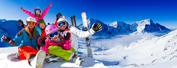 Family enjoying winter skiing fun Stock Photo 06