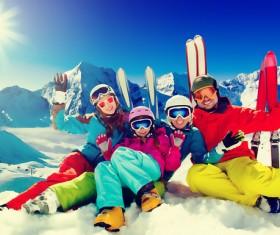Family enjoying winter skiing fun Stock Photo 07