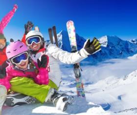 Family enjoying winter skiing fun Stock Photo 09