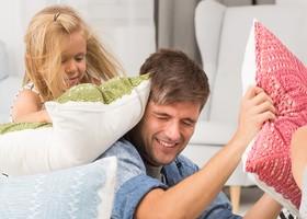 Family pillow fight Stock Photo