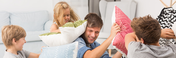 Family pillow fight Stock Photo