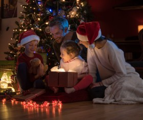 Family sitting together on Christmas Eve Stock Photo 01